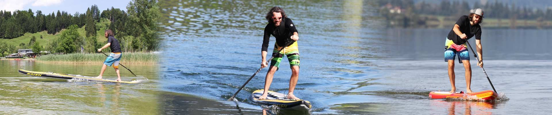 Stand Up Paddler mit Naish One und Fanatic Ray Air Premium